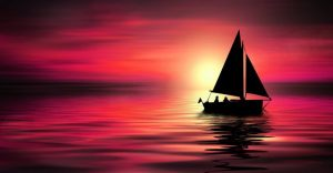 about conscious living - sailing boat in red sunset